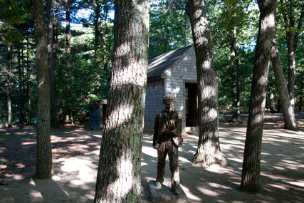 A statue of Henry David Thoreau and a replica of his hut are on display at Walden Pond Reservatio